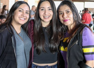 "(L-R) Mariana, Andrea, and Jess were impressed by all the creativity on display. ""I didn't even know what this would be,"" Mariana said. She particularly liked the F is for Fuck Trump coloring book."