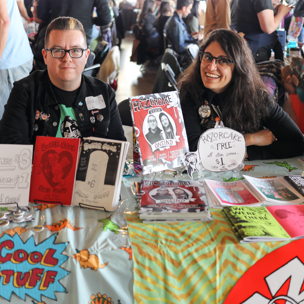 (L-R) Ricky Vigil and Donna Ramone head up the entrance table at Grid Zine Fest. Vigil's Super Cool and Stuff goes back to 2011, and Ramone has contributed to Razorcake for more than eight years.