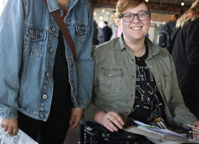 (L-R) Heidi Qin and Jae Miner wander from table to table. Qin loves independent publishing and she's studying education. Miner is a fan of letterpress techniques.