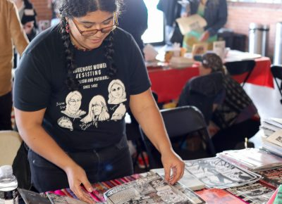 "Ellita designed the festival flyer art with Jorge Arrellano (not pictured). They're in the Nopalera Artist Collective, ""a cooperative of people of color, and migrant artists, in SLC, whose work relates to culture, resistance, and the resilience of our people,"" as stated on the gridzinefest.com website."