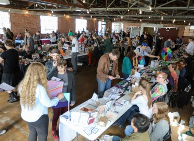 The Grid Zine Fest 2018 filled Publik Coffee's event space with 68 zine vendors and hundreds of guests. This free event included kid-friendly designations, a make-a-zine table and a 'Shy Guy' table for zinesters who prefer to publish anonymously.