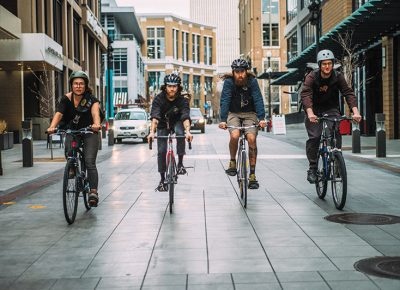 (L–R) SLC bike couriers Jessica Collette, Jake Matsukawa, Graham Abrams and Adam White deliver necessarily physical documents and packages with speed Downtown. Photo: Tyson Call