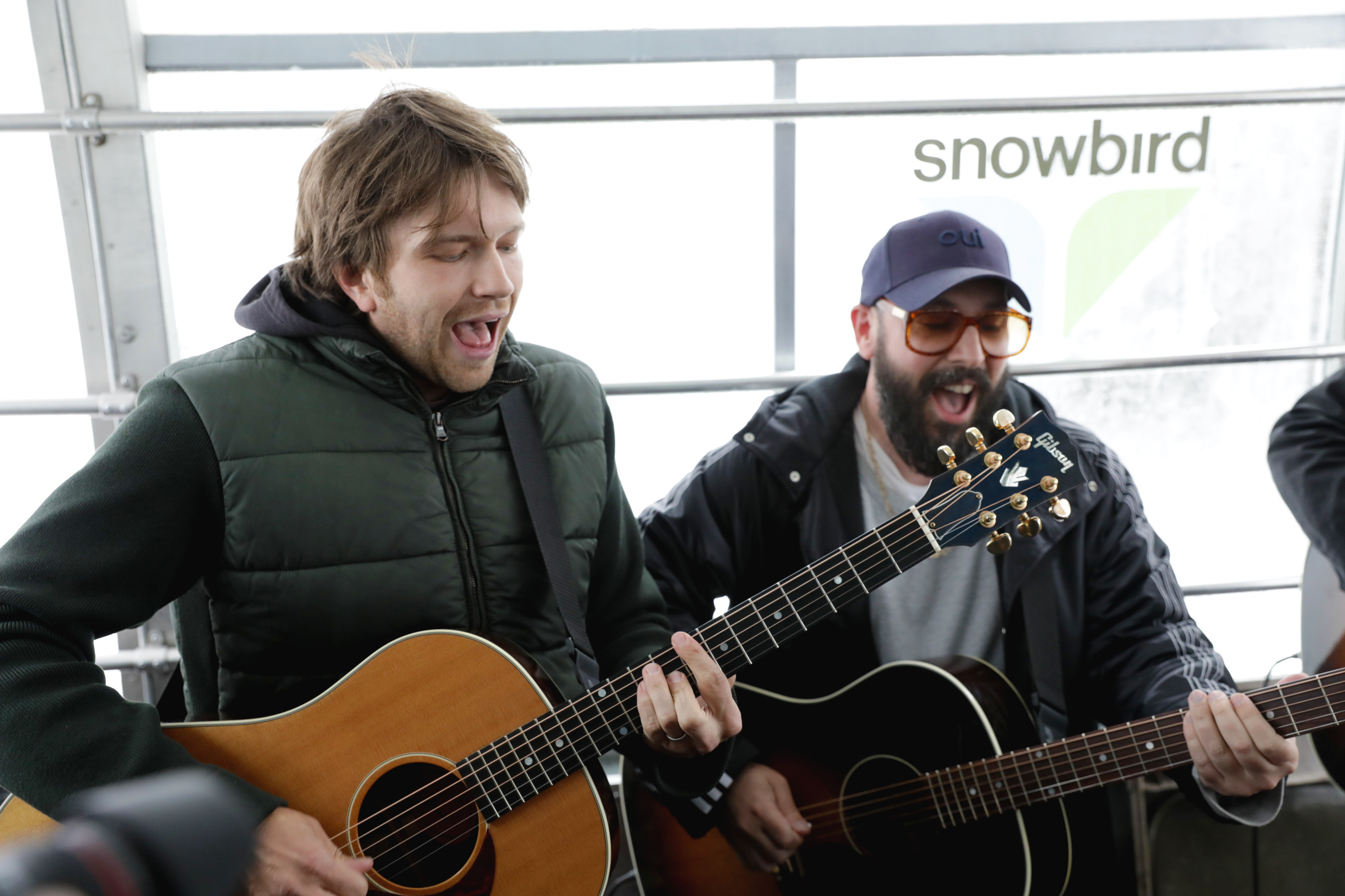 Andy Ross and Tim Nordwind playing and singing along as the tram climbs the mountains. Photo: Lmsorenson.net