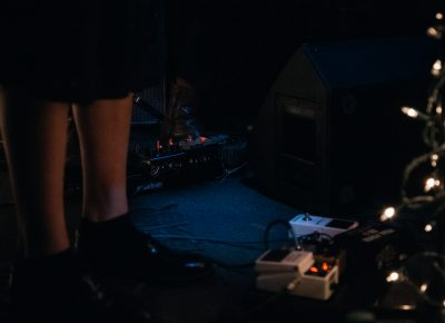 The dimly lit stage was illuminated faintly by the glow of Christmas lights and effects pedals. Photo: Matthew Hunter