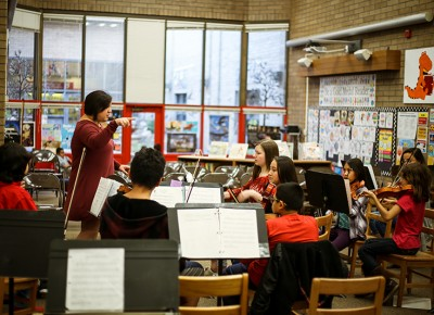 Victoria Petro-Eschler teaches a group of students at Jackson Elementary via the Salty Cricket Composers Collective's K–12 program. Photo: Kathryn Jones-Porter