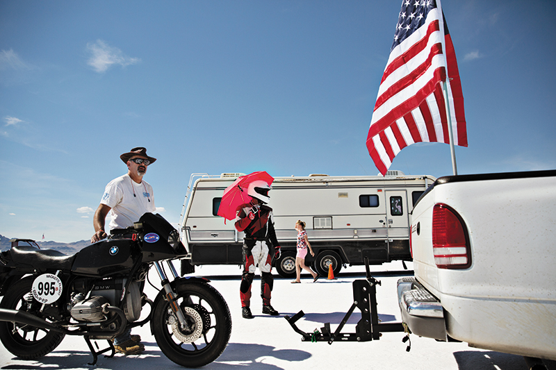 "Kim Raff, ""Spurs Jazz Basketball"" - Paul Makarushka from Denver, Colorado shades himself with an umbrella before attempting a land speed record on his 650 CC production pushrod motorcycle. ""When you look at the salt you don't realize that it can be like concrete,"" said Makarushka. ""It looks like it's soft. Like it's snow. But it's not. It's just amazing. You find a groove and you just go."""