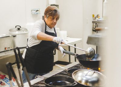 """Food has always been a family tradition."" Hungry Hawaiian's Kathy Mahiai prepares some sumptuous, home-style fare. Photo: Talyn Sherer"