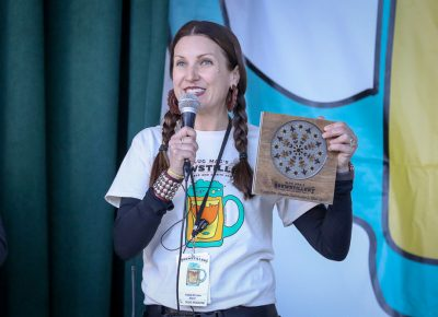 Angela Brown announces Brewstillery awards in four categories with plaques made by a local artisan. Photo: John Barkiple