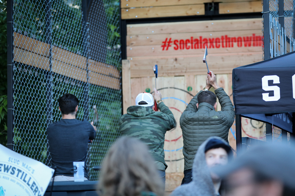 Etiquette is crucial to throwing axes withBeer and axes—#socialaxethrowing—say no more. Photo: John Barkiple grace and aplomb. Photo: John Barkiple