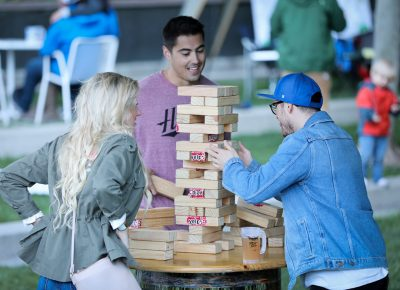 Beneath the bridge, a games area sponsored by Social Axe Throwing offered shade and distractions and feats of sobriety-testing dexterity. Only a confident Jenga player pulls blocks with a beer on the table. Photo: John Barkiple
