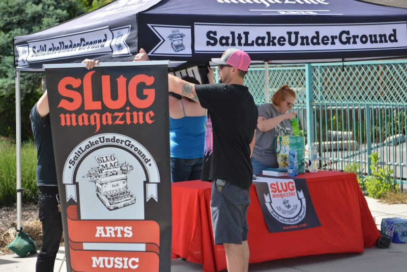 The SLUG staff setting up their booth.