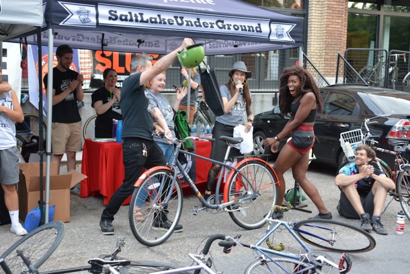 SLUG Cat women's category winner finding out her prizes included a brand new New Belgium Brewing city cruiser.