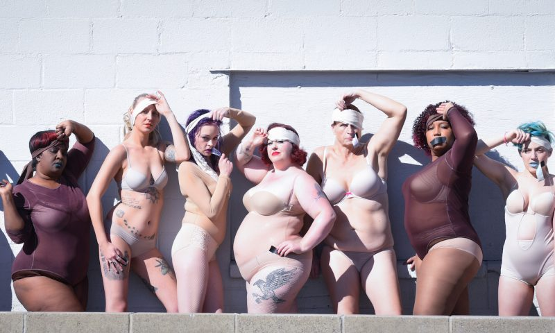 (Click image to view in full.) Pictured left to right, in response to the Exotic Kitty mural incident: Phoenix Phaedra, Myzchief Du Voodoo, Delta Rae Dixon, Suckerpunch Sally, Victory Red, Dominique Storni, Harpy L'amour, Madazon Can-Can, Havoq Luscivia. Photo: Rachel Barnes
