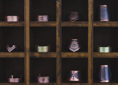 Some of the copper and brass cuffs made by House of Tebnebris sit on their beautiful display. Photo: Talyn Sherer