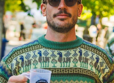 Strap Tank head brewer Mike Dymowski rocks the llama sweater after his recent trip to Peru, where he became inspired to explore new beer flavors. Photo: Talyn Sherer