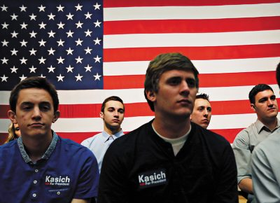 Spectators watch Republican presidential candidate Ohio Gov. John Kasich speak at a town hall event at Utah Valley University, Friday, March 18, 2016, in Orem, Utah. Photo: Kim Raff for, AP Photo