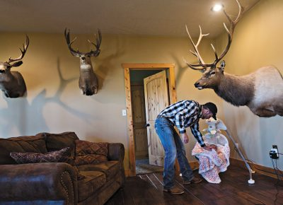 Andy Johnson tends to his baby daughter, Brookley Johnson, in their living room in Fort Bridger, WY on Thursday, September 3, 2015. Andy Johnson is a landowner who has become a conservative cause celebrity in the Western wars with the EPA. He dammed a stream to build a stock pond on his land, and in doing so, drew a thumping from the EPA, which ordered him to demolish it or face fines of $37,500 a day. He's dug in his heels and refused for two years, and decided to sue the feds. Photo: Kim Raff, for The New York Times.