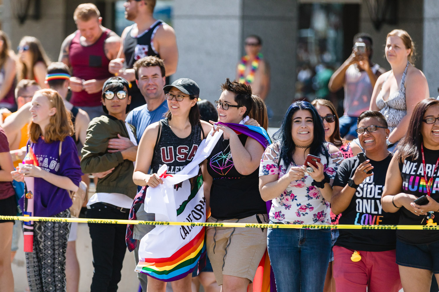 Parade attendees hold the California flag as a show of support for SLC Pride. Photo: Logan Sorenson | Lmsorenson.net