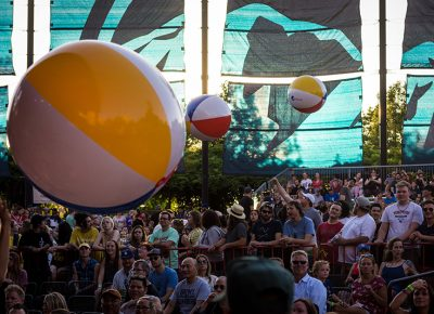 Bouncing Pepsi beach balls float above the crowd.