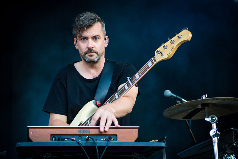 Bonobo gazes intensely at the crowd.