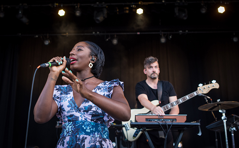 Vocalist Szjerdene joins the stage.