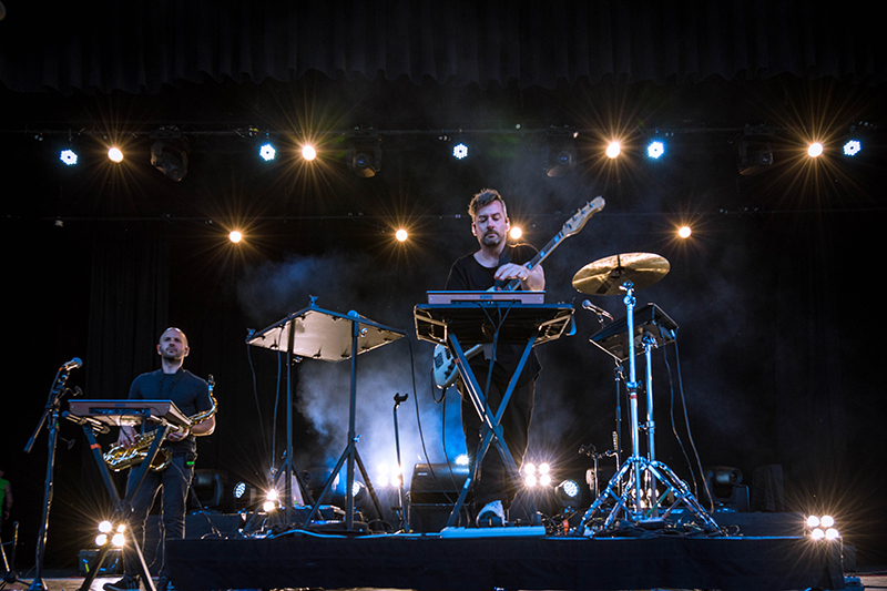 Bonobo performs among the shimmering lights.