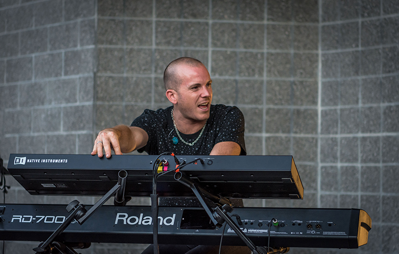 Keyboardist jams with the other band members.