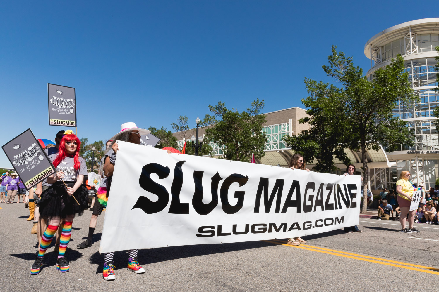 SLUG Magazine crew carry the banner throughout the whole parade as a show of love and support for SLC Pride. Photo: Logan Sorenson | Lmsorenson.net