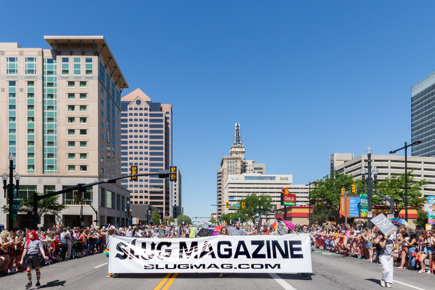 SLC Pride parade makes its way down 200 South , SLUG Magazine crew marching the whole way. Photo: Logan Sorenson | Lmsorenson.net