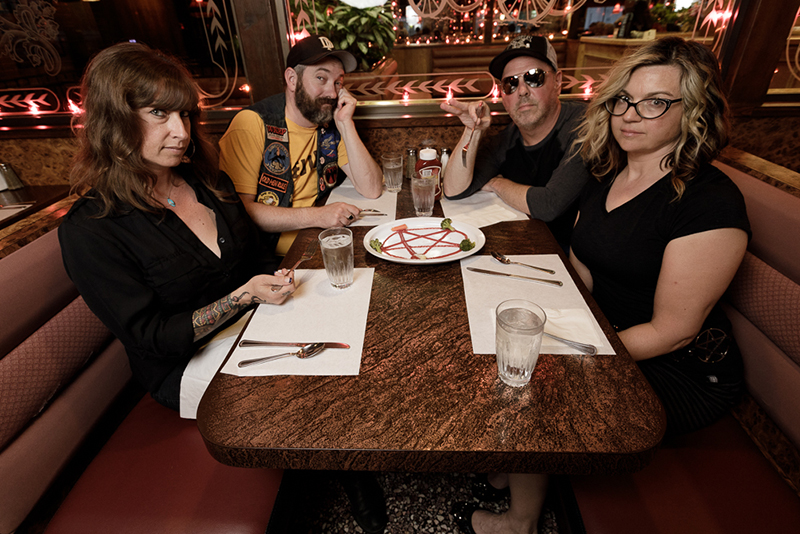 (L–R) Robin Brown, Mike Walton, Bill Frost and Angela Mize serve up heavy, hyperaggressive rock n' roll as Magda-Vega. Pictured here at Coachmans Dinner & Pancake House. Photo: John Barkiple