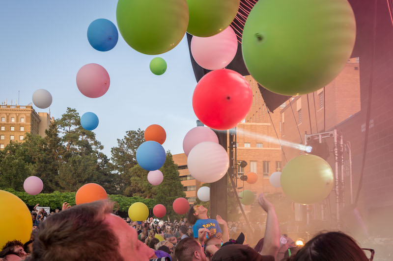 Large colorful balls float above the crowd. Photo: ColtonMarsalaPhotography.com