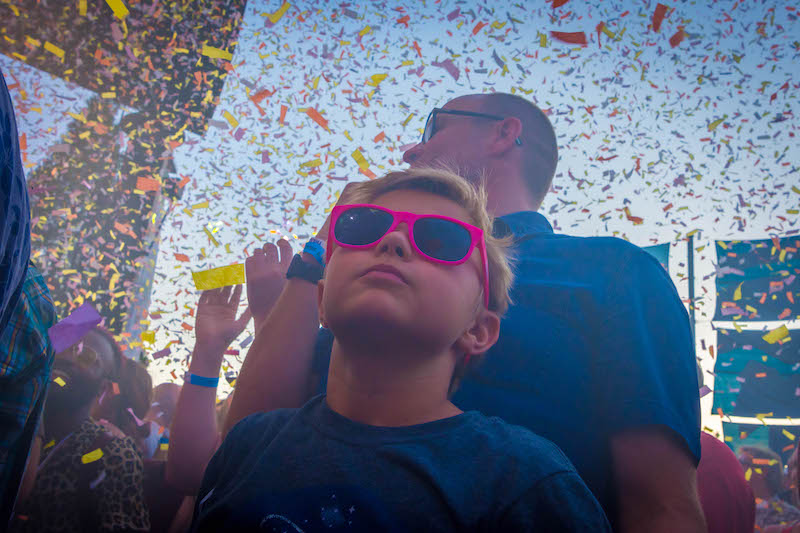 A young boy plays it cool as the confetti falls. Photo: ColtonMarsalaPhotography.com