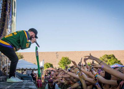 Quinn raps above the crowd.