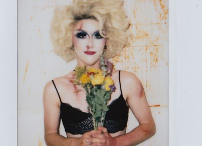 "As time has passed, and as he has experienced life in—and out—of drag, he's realized that dressing feminine makes him feel ""the most like a man. When I have a bra and huge hair on, it connects me more to my masculine side."" Photo: ThatGuyGil"