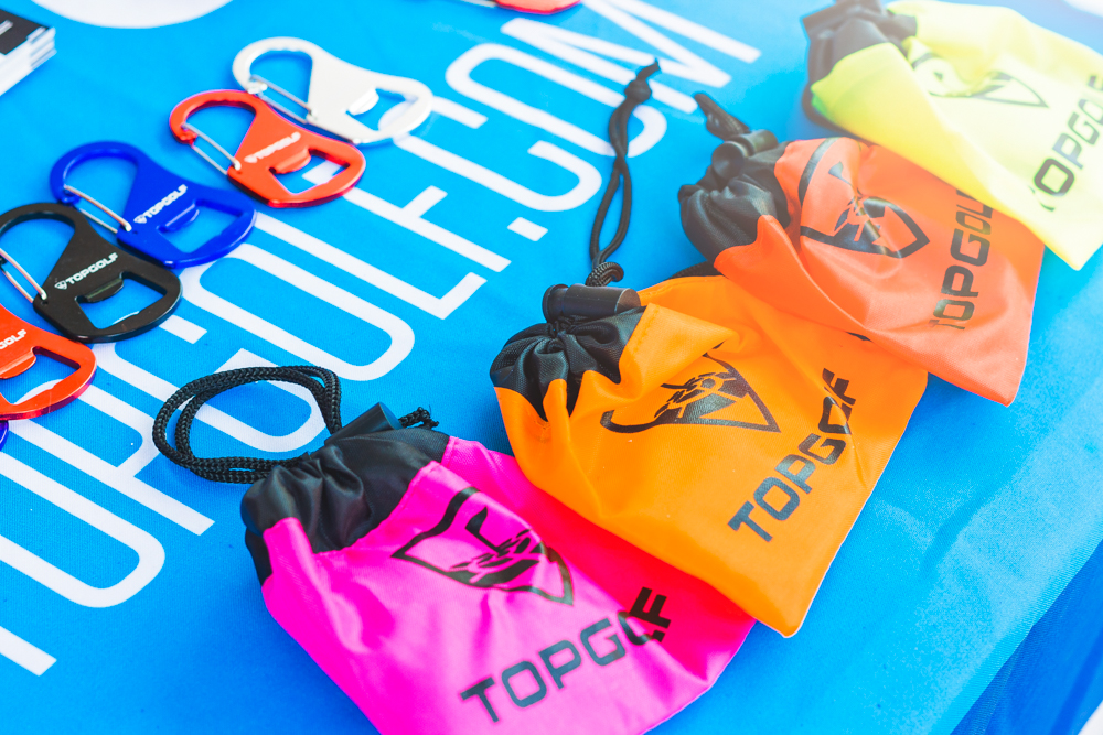 TopGolf draws a crowd with their brightly colored swag. Photo: Talyn Sherer