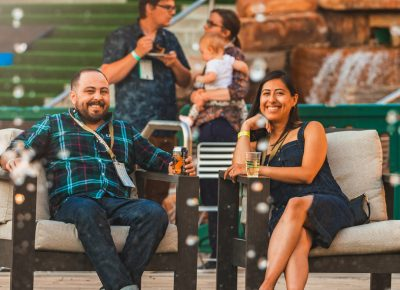 (L–R) SLUG Editor Alex Ortega enjoys a drink with his fiancée, artist Nancy Rivera. Photo: Talyn Sherer