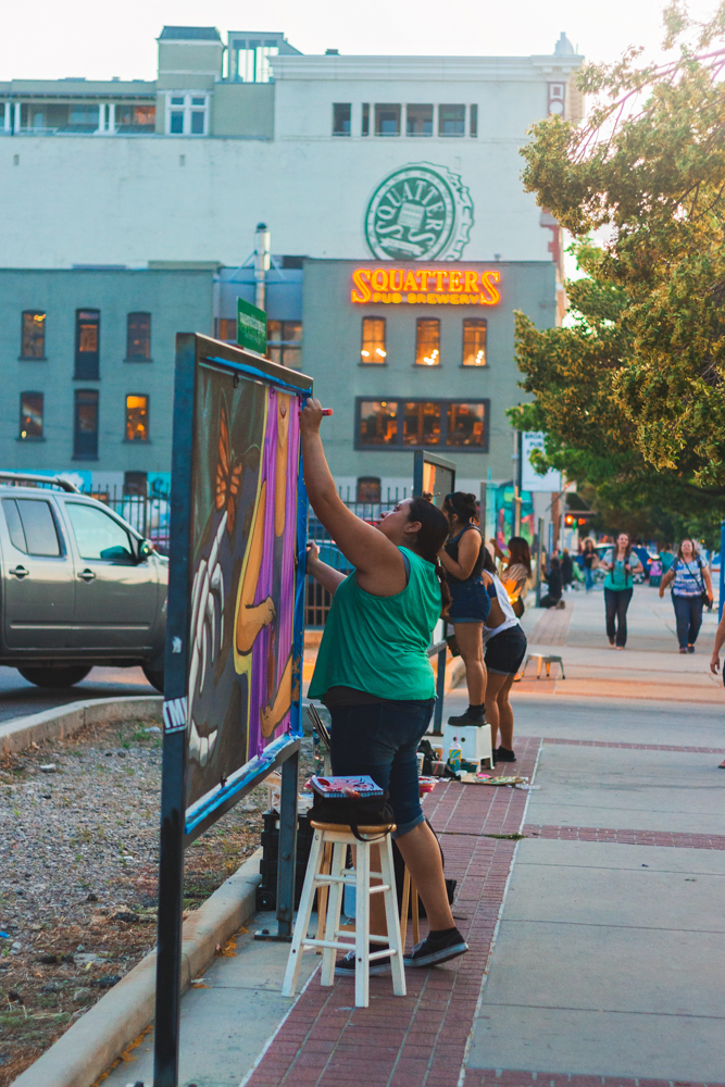 On the way to Squatters we get to enjoy the amazing artists at work who keep our city streets alive with color. Photo: Talyn Sherer
