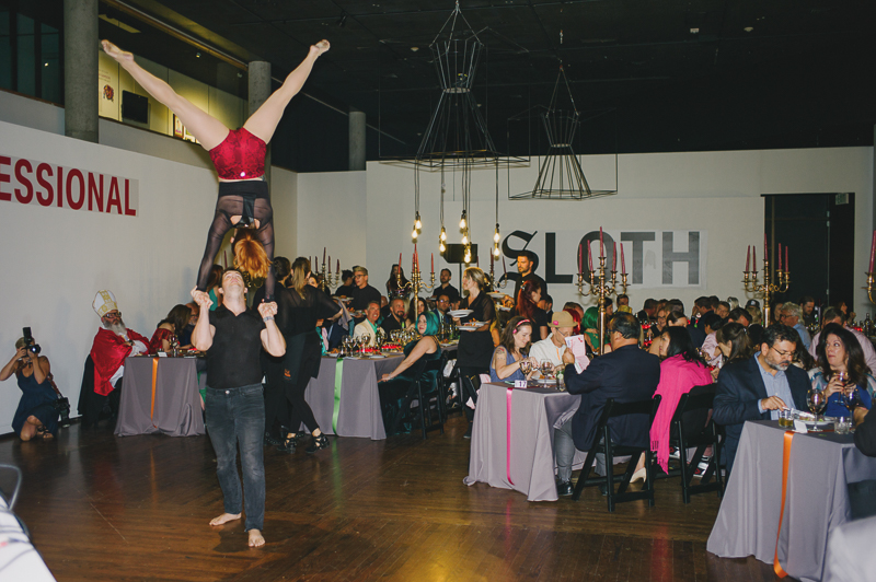 Guests watch as a performer balances above her partner. Photo: @clancycoop