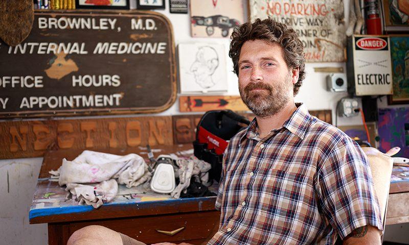 Murdock comfortably posed in his studio. Photo: John Barkiple