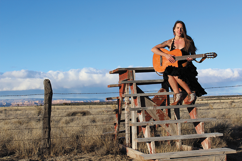 Burggraf displaying her guitar amid the Utah scenery. Photo: John Barkiple