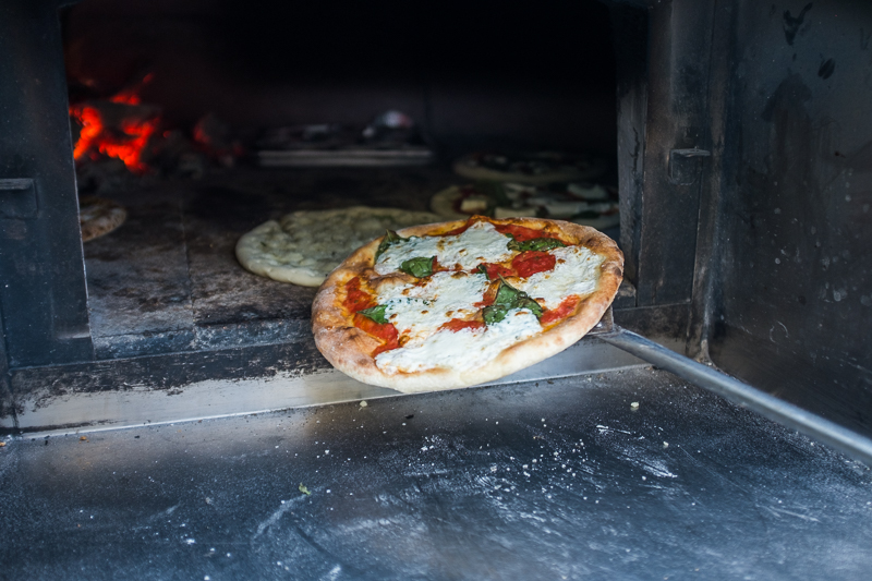 Fire and Slice Wood Fired Pizza was baking pizza fresh in their portable brick oven. Photo: @clancycoop