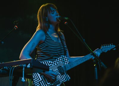 Jenn playing one of two custom Reverend guitars. Photo: Matthew Hunter