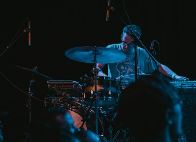 Andy Stack splitting focus between drums and keys. Photo: Matthew Hunter