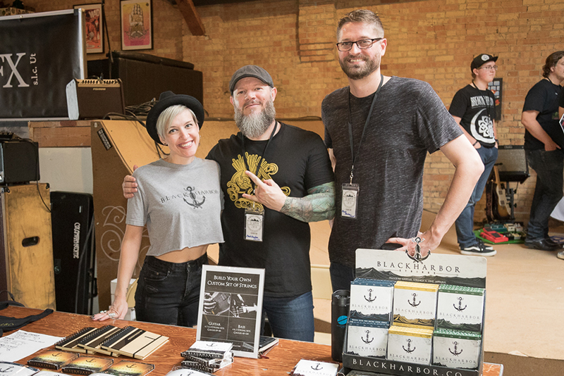 (L–R) Lizzy Tanner, Cory Jensen and Drew Ehrgott bring Black Harbor's strings to SLAMM. Jensen, a serial entrepreneur, designs his strings for better action at the pickups, and his custom blend of alloys prevents the additional fret wear that could occur. Find out more @blackharborsound.