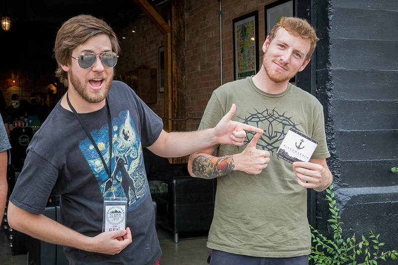 (L–R) Ben Gabrielsen and Alec Stanczyk step outside to take a break from SLAMM's heady buzz. Stanczyk bought Black Harbor strings, which he'll use when he plays in his band, Hemwick, up in Ogden.