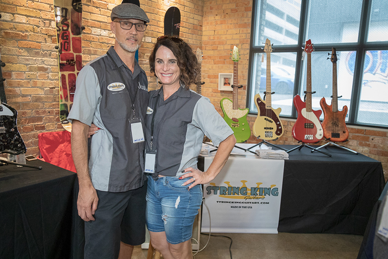 (L–R) Justin and Daphne Pearce from String Kings and Joe's Guitars filled their corner of SLAMM with beautiful guitars. Justin's String Kings is a production line with a two-to-three-week lead time for manufacture, and his Joe's Guitars line is fully customizable with a three-to-six-month lead time.