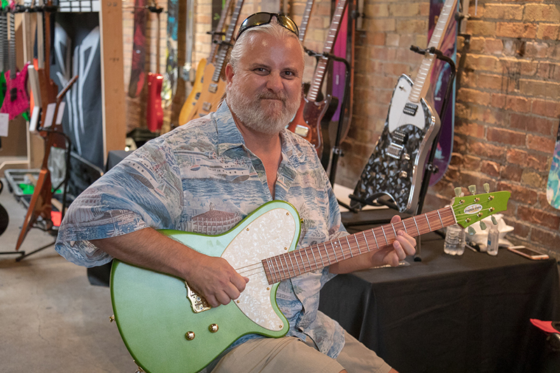 Mojave Jive's Christian Phelps demos a String Kings SKG T-Bone. When he's not playing in Mojave Jive, Phelps is helping to launch Summit Studios, which is just now opening.