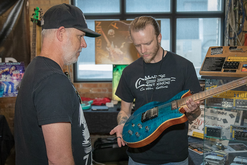 KSM Music's Repair Technician, David Kirkham (right) builds guitars on the side for his Malyse Intende company. He refinishes, burns and airbrushes 100-percent custom guitars to order