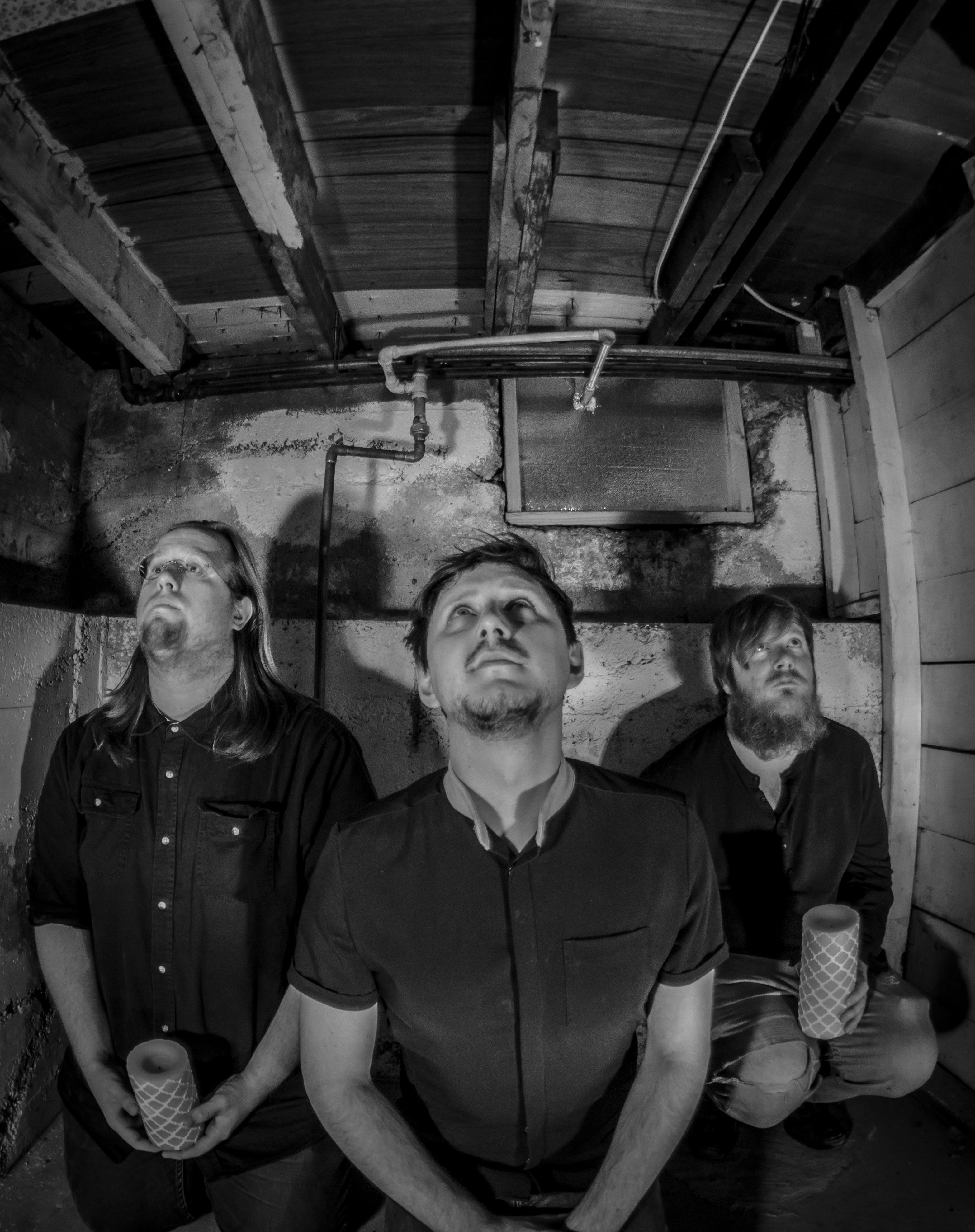 (L–R) Nicholas Allen, Chris Fallo and Marz Samuel Leizureman pose reverently. Photo: Randy Roberts