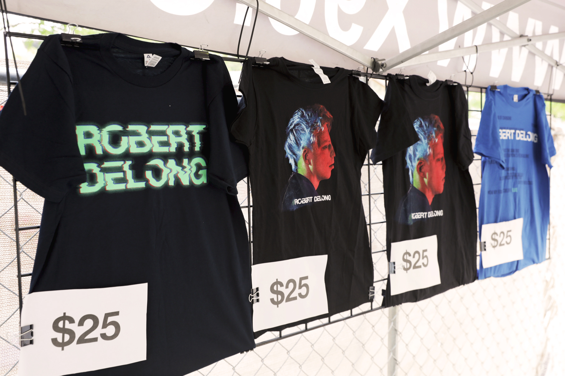 Robert DeLong Tees available to purchase at the merch tent. Photo: Logan Sorenson | Lmsorenson.net